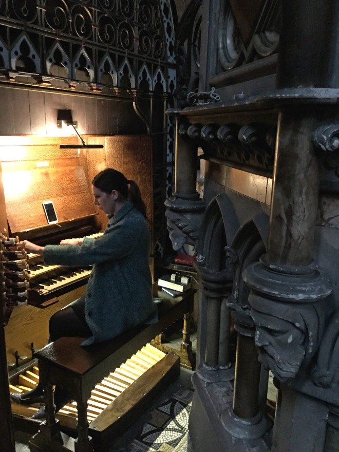 Claire Singer playing organ